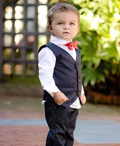 As a toddler: Ryan would wear a matching tuxedo and trousers that were plain black with thin white stripes on them. Under that he would where a white shirt and a red bow tie!
