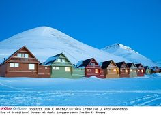 Row of traditional houses at dusk, Longyearbyen, Svalbard, Norway - Neige