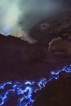 Awe-inspiring blue lava flows from volcanoes in East Java, Indonesia