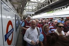 West Ham fans arrive at Upton Park Tube station before last weekend's game against Swansea - next season's stop will be Stratford