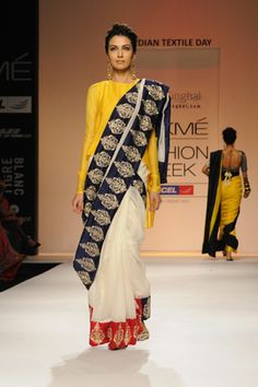Cream silk mul saree with red and navy embroidered silk borders worn with yellow silk mul high-low kurta choli. SHOP THE LOOK: http://www.payalsinghal.com/off-the-runway/naaz-mul-saree