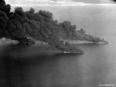 Ships of a Japanese convoy burning heavily off the coast of French Indochina on 12 January 1945. -U.S. Navy photo