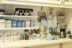 tiny vintage cluttered kitchen...love the shelves, sign, etc...probably already pinned this  :D