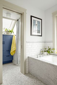 This bathroom features a pocket door which partitions off the shower and toilet for privacy.