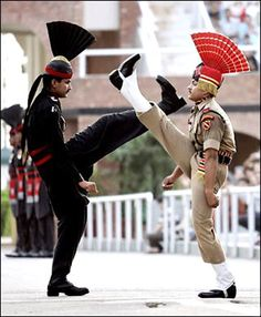 Wagah Border Ceremony near Amritsar - OMG shoes in the face, gotta see this ceremony some day. The one in black is from Pakistan & the other is from India. Amritsar, India Pakistan Border, Pakistan Zindabad, We Are The World, People Around The World, Nova Deli, Amazing India, It's Amazing, Amazing Photos