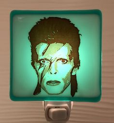 A personal favorite from my Etsy shop https://www.etsy.com/listing/509336183/david-bowie-night-light-fused-glass