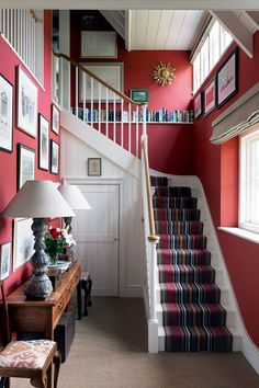 Red hallway in a modern rustic farmhouse. Ptolemy Dean's Sussex newbuild farmhouse. House & Garden UK, photo: Simon Brown.
