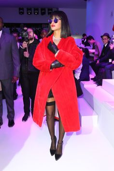 At Dior: Draped in pearls and a red mink coat from Dior's fall 2013 couture collection, Rihanna oozes old Hollywood glamour. [Photo by Stéphane Feugère]