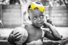 One of our community activities with African Impact - Victoria Falls was Kid's Club at the Rose of Charity Orphanage. On this day we played football and did some drawing and reading. I captured this cute boy with his yellow soccer hat! Isn't he the cutest?