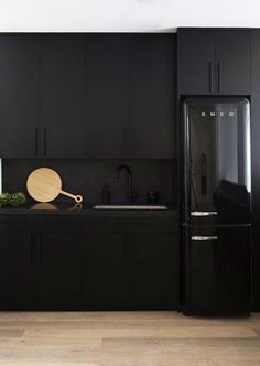 'Blackout' Kitchens Are All the Rage for Good Reason—Here Are 10 to Gawk At - matte black kitchen with polished concrete backsplashes - Modern Kitchen Design, Interior Design Kitchen, Home Design, Kitchen Designs, Design Ideas, Black Kitchen Cabinets, Black Kitchens, Kitchen Black, Kitchen Appliances