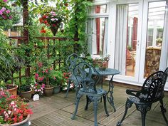 the classic balcony for a warm cup of coffee in the evening - rustic, green & colorful