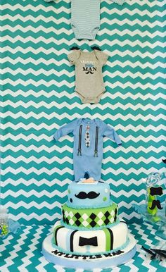 Cool cake and decorations at a blue and green baby shower party! See more party planning ideas at CatchMyParty.com