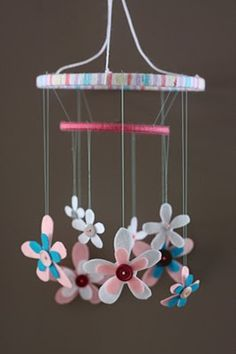 flower mobile for baby, made with dollar store felt fabric, buttons, card stock & fishing ling to hang