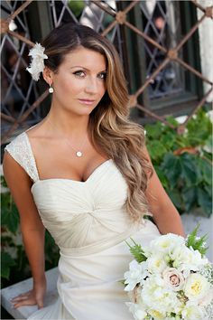 I love that hairstyle...pinning back one side with a large cute flower, and making loose waves on the other side