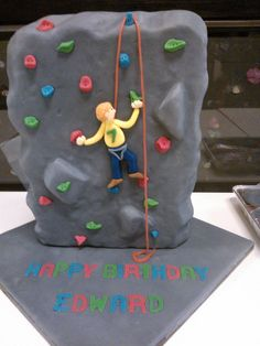 Rock climbing wall cake for 7th birthday. I used a quadruple quantity of Smitten Kitchen's brown butter marshmallow Rice Krispie cake recipe in a 12x9 inch tin that was about 4 inches deep. Fondant straight onto the cake.