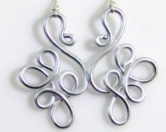 These wonderful fun earrings are made out of anodized aluminum textured silver wire 12 gauge. Aluminum is 1/3 the weight of steel making them super