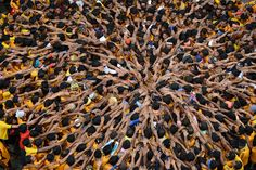 "Joining hands together is the ultimate symbol of unity. Devotees come together and try to form a human pyramid to break a clay pot containing curd on the eve of the Hindu festival of ""Janmashtami"".// Sudeep Mehta (Mumbai, India); Photographed August 01, 2012, Mumbai, India"
