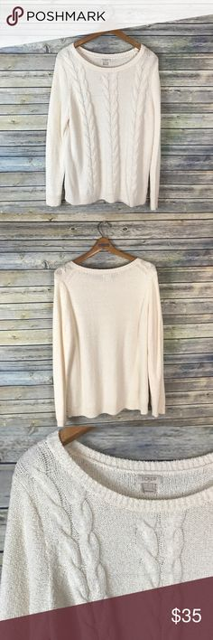 "J. Crew Factory Cream Cable Knit Sweater Very cute long sleeve off white/cream colored cable knit sweater. Gently used condition.  Measurements laying flat (without stretching)-- -Armpit to armpit: 23"" -Length, shoulder to hem: 26.5"" J. Crew Factory Sweaters"