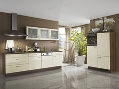 #Kitchen Idea of the Day: European Kitchen Cabinets (By ALNO, AG) with a warm color scheme.