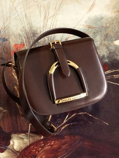 The Equestrian Collection Shoulder Bag    A delicate gold stirrup adds elegance to this preppy essential.