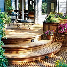 Deck that meets the door. Steps down with potting boxes on back of bottom bench facing the yard.