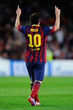 Lionel Messi of FC Barcelona celebrates after scoring his team's second goal during the UEFA Champions League Group H match between FC Barcelona and Ajax Amsterdam ag the Camp Nou stadium on September 18, 2013 in Barcelona, Catalonia.