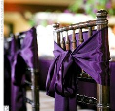 Another idea for some purple accents would be to tie the chairs with a purple bow.