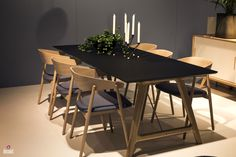 Fabulous wooden dining table with matching chairs and a dashing black tabletop A Natural Upgrade: 25 Wooden Tables to Brighten Your Dining Room