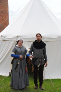 English couple at the end of the 14th century. Lady: linen chemise, cote simple (blue wool) as under dress, buttoned short-sleeved cotehardie (black and white wool), tippets (cream silk), kruseler (white linen), woolen hose, period leather shoes, belt, garters. Man: shirt and braies (linen), front-laced dublet (black and white wool), hood (wool with lining), separate hose (brown wool), period shoes, belt and garters (leather) All fabrics 100% natural. All parts completly hand-sewn.