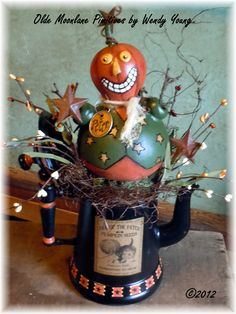 New 2012 Peter the pick of the patch pumpkin in a recycled teapot.