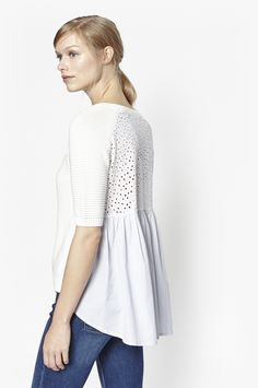 "<ul> <li> Ribbed jumper</li> <li> Short, almost elbow-length sleeves</li> <li> Round neckline</li> <li> Cut-out dot detail at back with flared hemline</li> <li> Curved hemline</li> <li> UK size M back length is 71cm</li> </ul>  <strong>Our model is 5ft 9.5"" and is wearing a UK size M.</strong>"