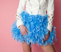 Soft and fluffy unique feather skirt that will be a total eye-catcher wherever you go. Waistband is made from Zack's unique flamingo print.