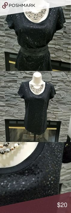 Beautiful Calvin Klein sparkly sequin top Adorable and comfy tee! The inside is soft against your skin while the black sequins reflect light making you look sharp. This is cute with jeans and heels, with a suit for work, or a skirt for date night. Calvin Klein Tops Tees - Short Sleeve