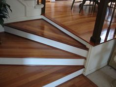 I like this look on stairs with porcelain flooring that looks like wood Just a lighter color. Ceramic Tile That Looks like Wood By Rung