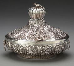 Silver Holloware, Continental:Holloware, An Egyptian Silver Repoussé Covered Dish, post 1946. Marks: (silverpurity mark), (lotus flower), (Cairo city mark). 8 inche...
