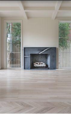 [CasaGiardino]  ♛  black marble faced fireplace surround, bleached strip and herringbone hardwood floor