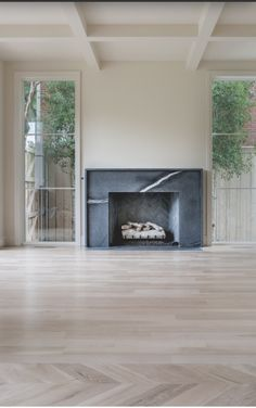 [CasaGiardino]  ♛  black marble faced fireplace surround, bleached strip and herringbone hardwood floor