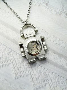 """Robot Necklace: from Jane: """"I love the dour expression. Made of a vintage watch movement"""""""