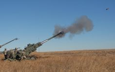 Gun one, occupied by a gun line team from 2nd platoon, Alpha Battery, 2nd Battalion, 32nd Field Artillery, 4th Infantry Brigade Combat Team, 1st Infantry Division, fires a 155mm M777 Lightweight Howitzer during a live fire exercise at training range 52 on Fort Riley, Kan., Jan. 23. The 2-32 FA is the first battalion in the 1st Infantry Division to fire the M777 on Fort Riley. U.S. Army photo by Sgt. Gene A. Arnold, 4IBCT PAO
