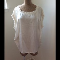 JOIE Silk Cream Top Very cute , casual oversize 100% silk woven top.......small dark smudge on the back which i attached a photo of.. Right below collar on the back of garment. Very cute top❤️ Joie Tops