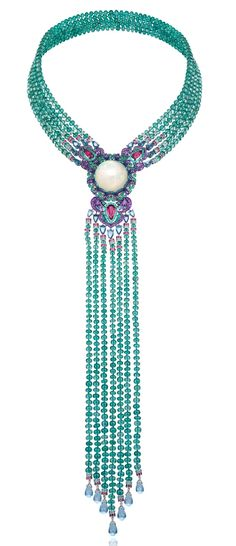 Necklace in 18ct white gold and titanium featuring a 29.8cts black opal and set with emerald beads (413cts) – topazs (29cts) – amethysts (5.9cts) – rubies (4.4cts) – Paraiba tourmalines (4cts) – rubelites (3.9cts) – emeralds and sapphires