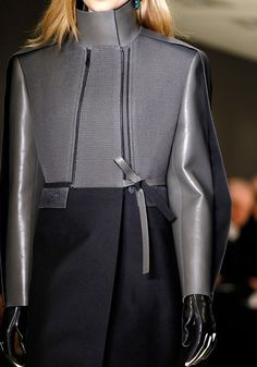 Balenciaga. I love the mix of hard/military & the satin feminine bow. Urban warrior chic.