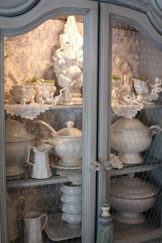 I have two cabinets with very similar lines...Im going to put chicken wire on one of them! Love it!