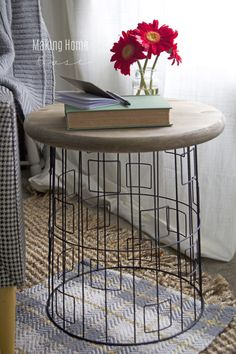 Laundry Basket End Table - unique wire basket and wood table top. What a great simple idea.