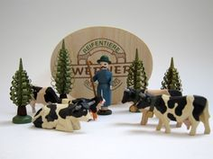 """A delightful set of hand-carved ring animals in their own wood-shaved  box from the Christian Werner workshop in the Erzgebirge, Germany:  4 trees, Shepherd (2-1/2"""" tall), 5 black and white cattle and 1 Bernese mountain dog. Available at www.mygrowingtraditions.com"""
