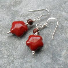 Mookite which are deep brick red in colour with small 4 mm round mahogany obsidian semi precious gemstones are attached to sterling silver ear wires with some sterling silver wire being wrapped around the top of the earrings All metals used are 925 ste. Small Gift Boxes, Small Gifts, Wire Wrapped Earrings, Drop Earrings, Flower Bracelet, Semi Precious Gemstones, Wire Wrapping, Sterling Silver Jewelry, Gifts For Her