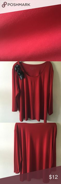 Red top w/rose embellishments by Susan Graver-2X. •Red knit top w/rose embellishments on shoulder by Susan Graver-2X. •92% Polyester/8% Spandex-Smooth/stretchy fabric. 📦Next day shipping. ☘️Open to offers on all listings. Susan Graver Tops Blouses