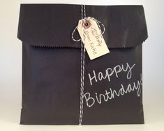 Black kraft bags you can write on with a chalk pen. Cute gift wrapping for Christmas too! From Supply House 27.