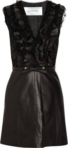 Valentino dress: black leather, lace bodice with tan tulle and organza underlay, V-neck, ruffled trims, detachable bow-embellished leather belt, side slit pockets, fully lined. Concealed zip fastening at side.