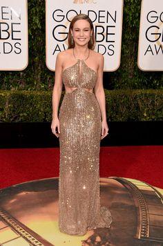 Brie Larson wears Calvin Klein at the Golden Globes, looking like a golden goddess